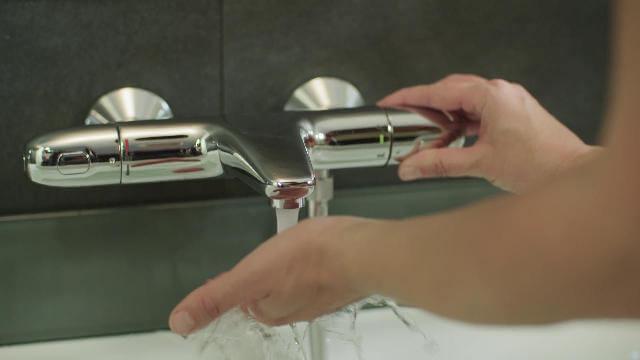 термостатический смеситель Грое в ванной